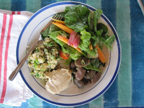 herbed quinoa, fava beans with parsley and garlic, humus and salad with dijon mustard dressing